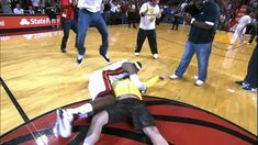 Check out this wild highlight of one lucky Heat fan who throws up a one-handed hook shot from half court and sinks it for dollars, much to the delight of all the fans & players in the arena, especially LeBron James, who storms the court and tackles him! Half Court Shot, Heat Fan, Basketball Videos, Combat Sport, Brazilian Jiu Jitsu, Latest Video, Lebron James, Viral Videos, Youtube