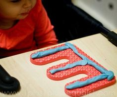 Use large foam letters and play dough together to work on letter recognition in a fun way!
