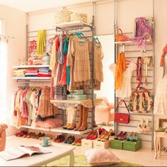 You don't always have to have flat walls of clothes, I like the idea of trying to make the shop, the best ever walk in wardrobe you could come across - every women's idea of heaven!!