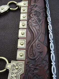 The Dog Seax. Details of the fighting dogs on the sheath and the file work on the blade.