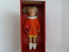 This Sylvia Natterer Gotz-Puppenfabrik Fanouche doll is wearing an orange dress with orange jacket, yellow under-dress and off-white casual shoes; she has a yellow flower in her hair. Her beautiful blue eyes are open and with her long blonde hair, she is stunning. | eBay!