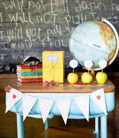 Back to School Party Ideas   Back to School Party Themes   Props include globe, apples, books and other small baubles