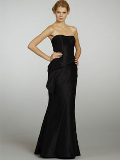 Dupioni soft fluted bridesmaid gown. Strapless neckline with architectural cascading and structured peplum at natural waist, asymmetrical seam placement throughout skirt.