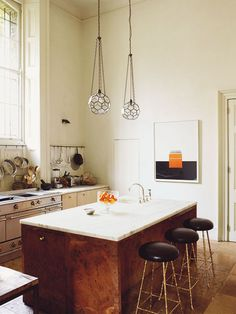 Love the play of cabinet textures and colors, globe lanterns