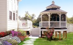 Extend a deck with a screened-in gazebo with a pagoda-style roof