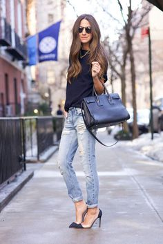 Spring Outfits 2015: 50 Flawless Looks to Copy Now - a casual black t-shirt tucked into light washed + cuffed slim jeans, worn with gold and black pointy toe heels