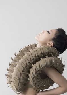 Wearable Art - sculptural fashion with shape repetition spiralling 3D structure; conceptual fashion design