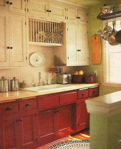 Country kitchen. Beadboard backsplash, white and red cabinets. Green walls. Love