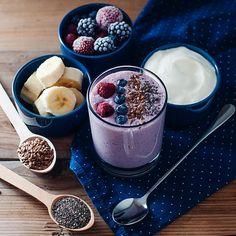 Banana, chia seeds, blueberries, strawberries, Greek Yogurt, flax seeds, raspberries, coconut water and blackberries smoothie. AKA deliciously healthy in a cup.
