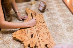 Wedding guestbook idea - guests signed a North Carolina-shaped piece of wood! {Keepsake Memories Photography}