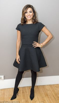 Stunning: The US star looked gorgeous in a simple but chic little black dress and opaque tights for her TV appearance
