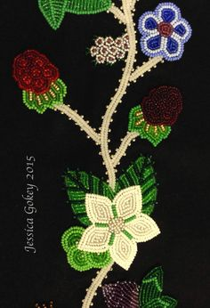 Close up on panel for MNHS Project: Designed and beaded by Jessica Gokey  Blackberries at different stages of growth and a blossom