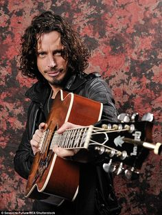 Sad: Soundgarden rocker Chris Cornell has died in a 'suspected suicide' aged 52 just hours after performing a gig in Detroit on Wednesday night - pictured in 2009