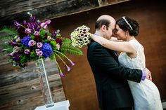 A peek at the bride's oh-so-chic calla lily bouquet along with vibrant floral displays | Seven4one in Laguna Beach | Henry Chen Photography