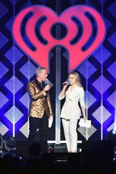 Sabrina Carpenter Photos - Elvis Duran and Sabrina Carpenter speak onstage at the Jingle Ball 2017 on December 2017 in New York City. (Photo by Dia Dipasupil/Getty Images) * Local Caption * Sabrina Carpenter; Elvis Duran - Jingle Ball 2017 - Show Disney Original Movies, Sabrina Carpenter, New York City, Celebs, Concert, December, Photos, Celebrities, Pictures