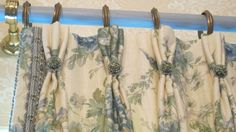 Linen Floral with custom trim and rosettes www.lindafloyd.com