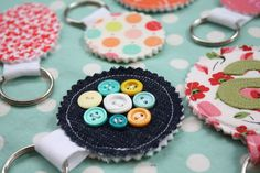 fabric scrap key chains. these would be cute printed with a picture before you cut the fabric.. you could personalize them any way you want..