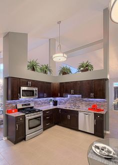 Kitchen dark cabinets lighter grey walls reno home for Dark orange kitchen