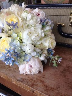 Romantic bouquet of ivory and blue.  LOVE this, sub sub blue hydrangea + tweedia for purple lilacs + wax flowers.