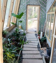 China Earthship - I like the look of the bottle wall. I think it would work really do well/ best in an earthbag home