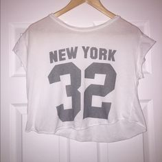 Brandy Melville (John Galt) 'New York 32' Crop Tee This crop is NWOT! In perfect condition. Bought a while ago, but never worn! White cropped tee with grey lettering. Size is labeled as OS. Such a cute, simple tee! Brandy Melville Tops Crop Tops