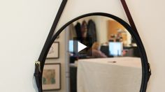 Inspired by leather-wrapped round captain's mirrors that can cost as much as $2,000, style editor Morgan Michener demonstrates how to make your own using an Ikea Grundtal Mirror and leather belts. Hang it in your entryway, living room or dining room!