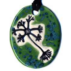 Multipolar Neuron Ceramic Necklace in Spotted Green. $18.00, via Etsy.