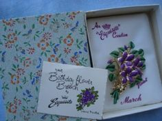 cold enamel Violet pin by Exquisite Jewellery Ltd., of Solihull, Warwickshire, England.  It was one of their range of Birthday Flower Brooches introduced and extremely popular during the 1960's.  These pins came in two sizes with a flower for every month of the year