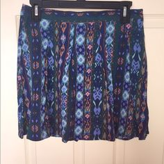 Forever 21 skirt Forever 21 skirt with an array of blue and orange, fun, light and flowy skirt with a side zipper. Excellent condition! Only worn once. Forever 21 Skirts