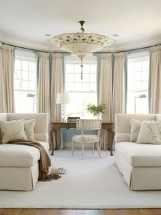 what's not to love? drapery, fortuny light fixture, chaises, toss cushions, area rug, desk & chair
