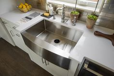 The stainless steel apron sink is a little bit modern, a little bit rustic, and a whole lot awesome. --> http://www.hgtv.com/design/hgtv-smart-home/2015/kitchen-pictures-from-hgtv-smart-home-2015-pictures?soc=smartpin