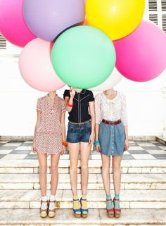 Balloons? They seem fun, playful, and colorful. If we wanted any fun candid shots, these would be good!