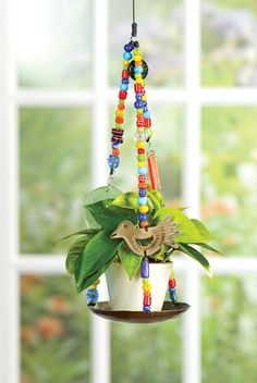 SALE: Glass Beaded Plant Hanger - UNICEF Cards & Gifts support a great humanitarian cause! ($9.99) Artisan-crafted glass beads and two large glass accents.