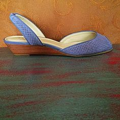 Beautiful purple faux snakeskin shoes by Talbots These low-heeled open-toed shoes are the most gorgeous shade of soft purple.  They are real leather with a faux snakeskin print   Near perfect condition - hardly worn and look brand- new.  Size 8 1/2. Talbots Shoes