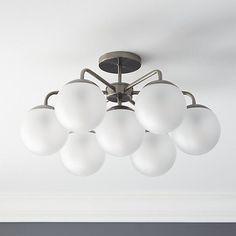 Free Shipping.  Shop vega black nickel flush mount lamp.   Designer Donna Piacenza reimagines the glamour of retro globe bulbs in a new light.