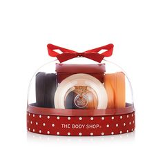 This festive season, introduce them to a world of Body Butters with The Body Shop's Best of Body Butter Festive Dome Gift Set! With fruity, floral and nutty flavors, this fun snow-globe-shaped gift is the perfect way to discover our iconic best-seller. With Community Fair Trade shea butter from Ghana, holiday presents don't get much more indulgent! Includes Mini Coconut Body Butter, Mini Shea Body Butter, Mini Moringa Body Butter, Mini Strawberry Body Butter, & Mini Mango Body Butter.
