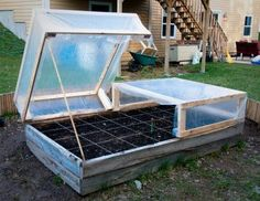 "DIY Raised bed cold frames. Good concept, example shown is too wide to service center square feet when the frames are installed for the winter. (Rule of thumb says, ""Never have to reach further than 2 ft. into a raised bed which makes four feet the widest span with access from both sides; 2 ft. the widest span if the raised bed is against a wall or obstruction or has a hinged cover mounted on one edge.)"