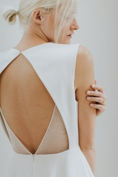 Open back wedding dress details by Charlotte Simpson: