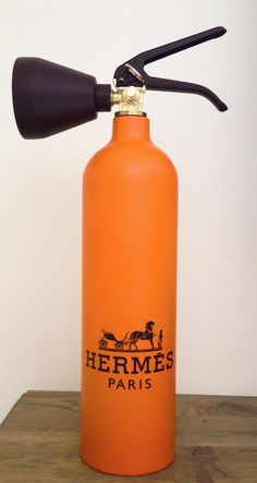 Hermes Fire Extinguisher by Niclas Castello | Sculpture made from an emptied ceramic fire extinguisher and turned into a unique luxury brand collectable item | 10 x 20 | Orange | http://guyhepner.com/?p=6904