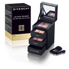 Givenchy Les Mini Prismes Travel Set. Viper Verdict: Cute and well made set of drawers. Pans are tiny, don't expect full size products. I love the warm pink blush, good everyday colour on paler skins. The powder is yellow toned with a slight greenish hue, good for olive toned skin around N13 to N20. The eyeshadows are so small they may be hard to use for someone using bigger brushes. Applicators useless. Scented with an unusual tobacco like perfume. 8/10
