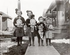 Vintage photo of four children with dolls circa 1920's. Girls with Schoenhut dolls and boy with Schoenhut elephant