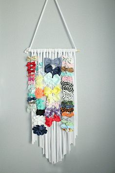 Our Hair Bow Hanger is perfect for every bow lover out there. It is designed to hold over 100 clips easily. This bow organizer makes it simple and easy to store all of your little girl clips, while created a hair bow display as well. Dont hide all their cute bows in a tupperware or a drawer. Let your daughters style hang on the wall for a toddler room decor instead!  The listing is for 1 hair bow holder in WHITE.  This fringe bow organizer is perfect for the boho minimalist to organize all…