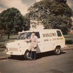 Digital Photograph - Man standing in front of 'Haslem's' Wine & Spirit Merchant Delivery Van, Yarraville, 1965
