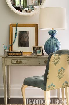 A blue desk lamp brings a pop of color to the muted space. - Photo: John Bessler / Design: Katie Leede