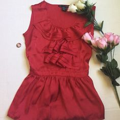 🆕NWOT Red ruffle top🌼 Brand new without tags. Pictures look orange but top is a gorgeous dark red. Ruffles at top and tie on back. Dress top. Antilia Femme Tops