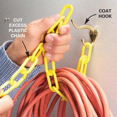 diy home sweet home: 10 Ways to Control Cord ClutterHang larger cords using a chain and a coat hook.