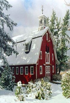 Winter Wonderland | Beautiful red barn in the winter snow. Love the hay loft window and doors