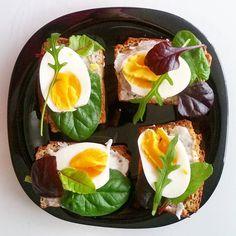 Eggs, gluten-free buckwheat bread and greens. Healthy breakfast.