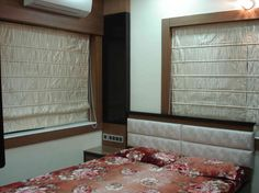 Bedroom with window blinds, Design by Arpita Doshi architect in Kolkata, West Bengal, India.