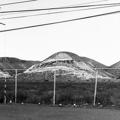 Rolling Landscape  #builtlandscape - #Baja #BajaMexico #BajaCalifornia #Mexico #roadside  #exploreMexico #bnw #blackandwhite  #bw_society #bnw_captures #bnw_mexico #scenesofMX #scenesofmexico #visitmx #mexicophotography #exploremx #MX #daylight #travel #travelgram #NorthAmerica #landscape #built #fence #cables